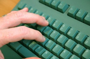 fingers on keyboard clicking